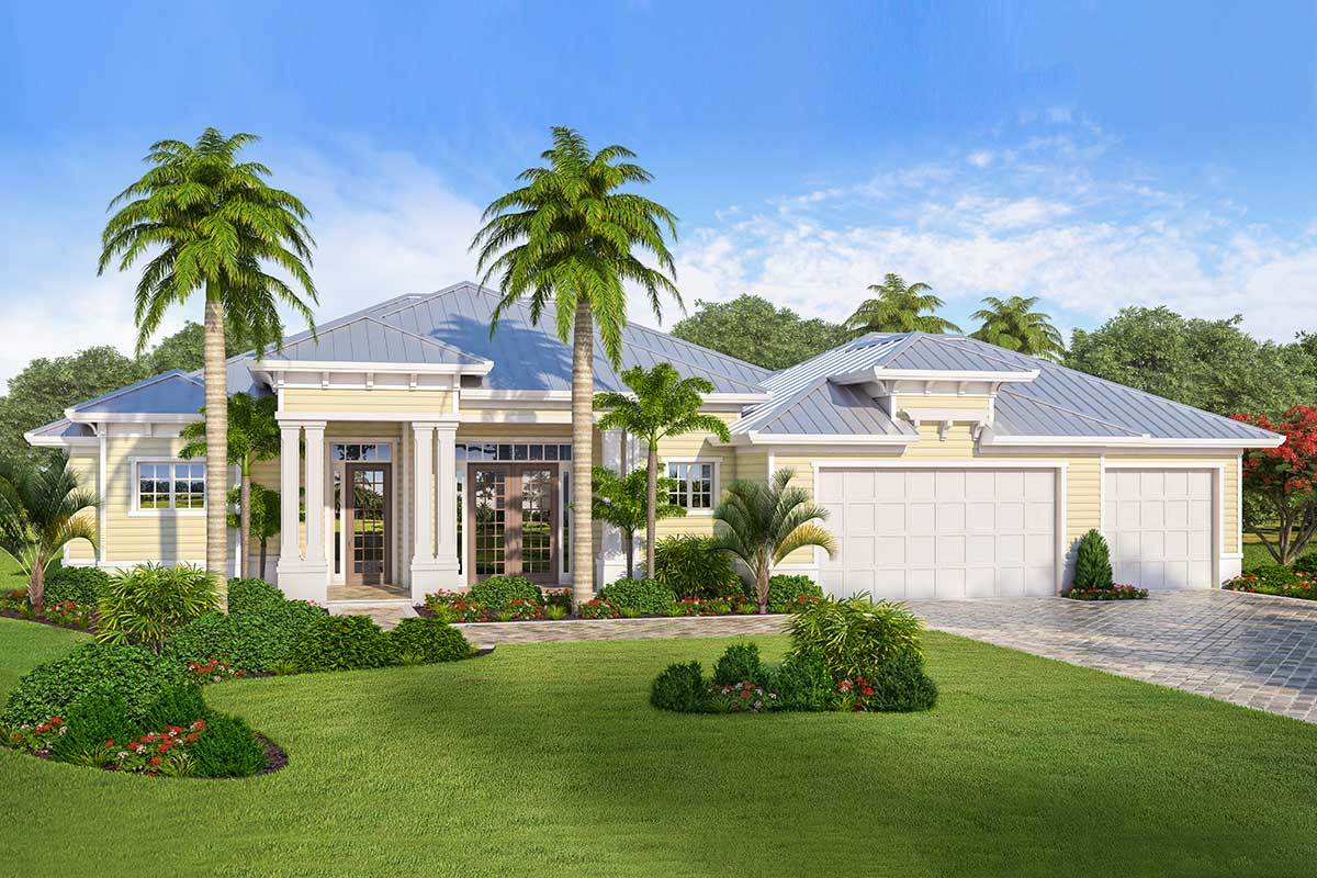 The home is graced with towering palm trees, manicured shrubs, and a green lush lawn.