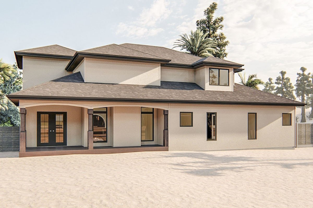 Home's rear view with pristine stucco exterior and a covered lanai framed with open arches.