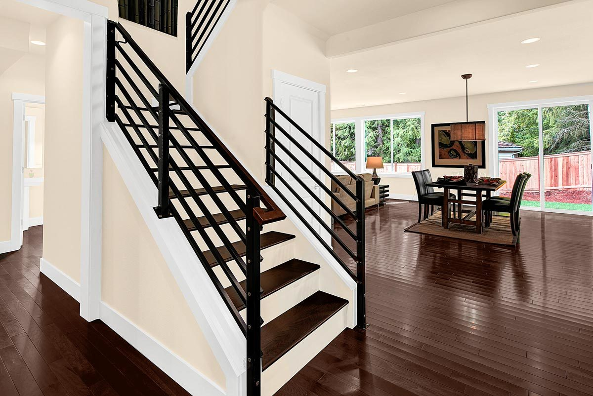 Traditional staircase with closet storage on the side enclosed in a white door.