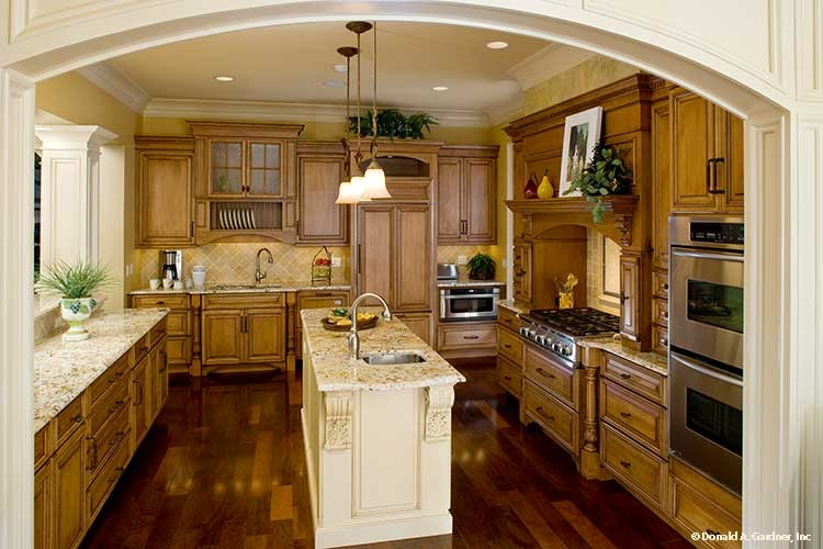 The kitchen is equipped with granite countertops, natural wood cabinets, stainless steel appliances, and a center island fitted with an undermount sink.