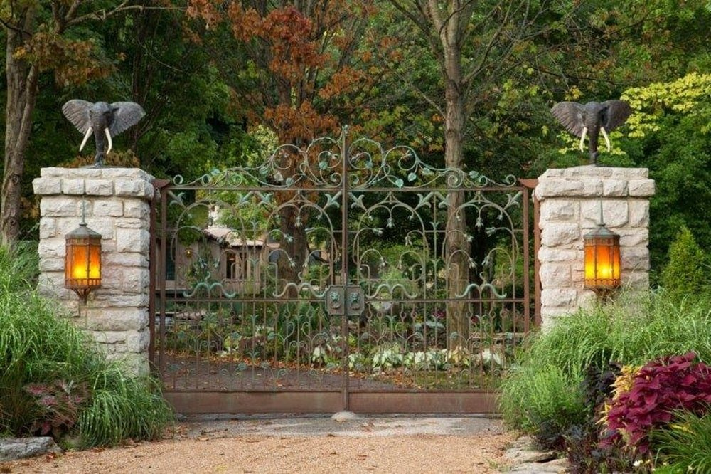 This is a look at the property from the vantage point of the main gate with a couple of rough stone pillars adorned by elephant statuettes and wall lamps. Image courtesy of Toptenrealestatedeals.com.