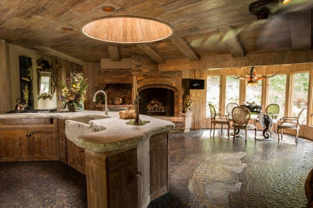 This angle of the kitchen shows the proximity of the kitchen to the dining area on the far side. Image courtesy of Toptenrealestatedeals.com.