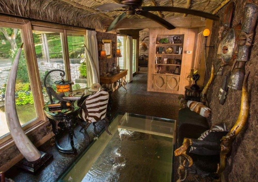This is the home office that has a thick glass flooring showing the water scenery below. Image courtesy of Toptenrealestatedeals.com.