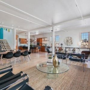 This is the great room of the loft apartment that houses the living room area, dining area and kitchen on the far corner of the spacious great room. Image courtesy of Toptenrealestatedeals.com.