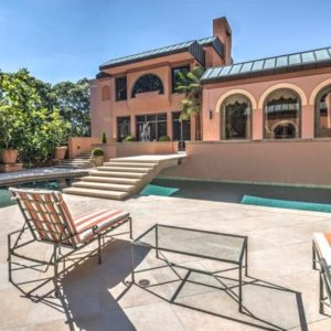 This is a look at the back of the house from the vantage of the poolside area. You can see here the earthy tone of the house exterior with arches and pillars. Image courtesy of Toptenrealestatedeals.com.