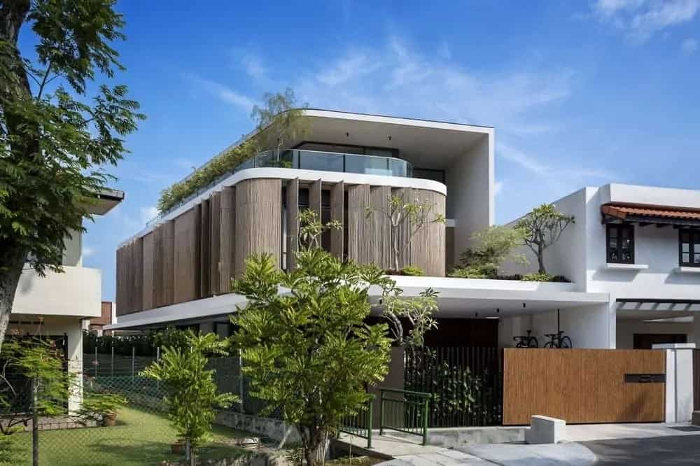 This is a front view of the house with distinctive and unique bamboo panels on the second level that can be turned on its axis to adjust the natural lighting that comes in.