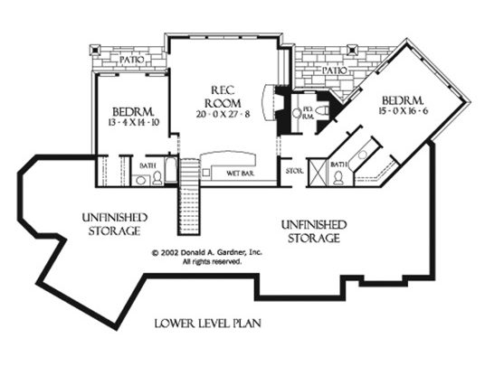 Lower level floor plan with two additional bedrooms and a large rec room with a wet bar and patio access.