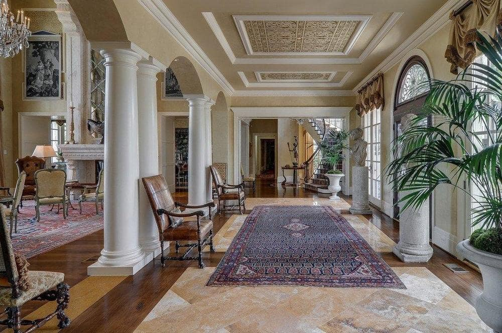 Upon entry of the house, you are welcomed by this foyer with arches and pillars leading to the living room. Image courtesy of Toptenrealestatedeals.com.