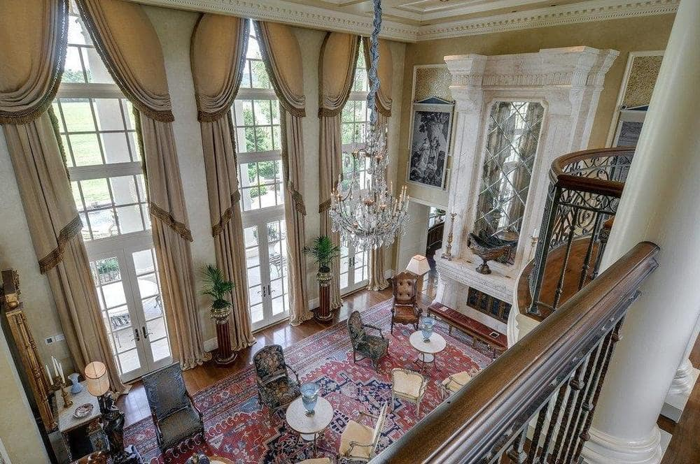 This is the view of the large living room from the vantage of the indoor balcony. Image courtesy of Toptenrealestatedeals.com.