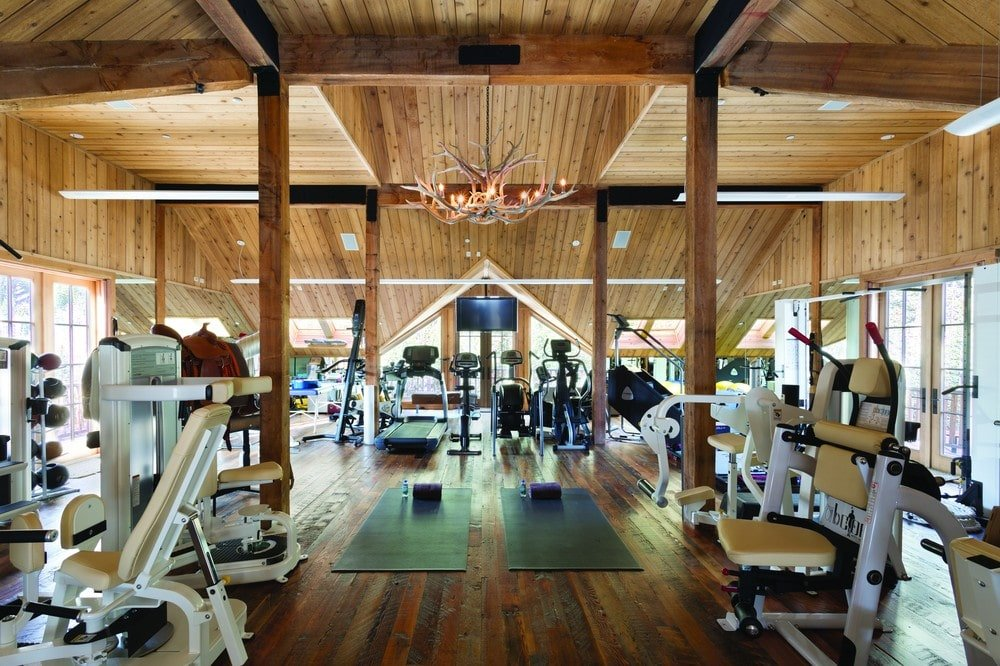 This is the fully equipped gym with enough space to fit several machines all under one large arched wooden ceiling. Image courtesy of Toptenrealestatedeals.com.