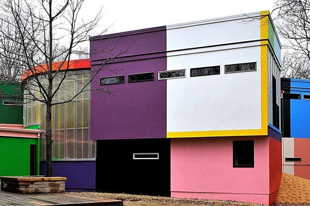 This closer look at the front of the house shows a large frosted glass wall that stands out against the vibrants different colors of the exterior walls. Image courtesy of Toptenrealestatedeals.com.