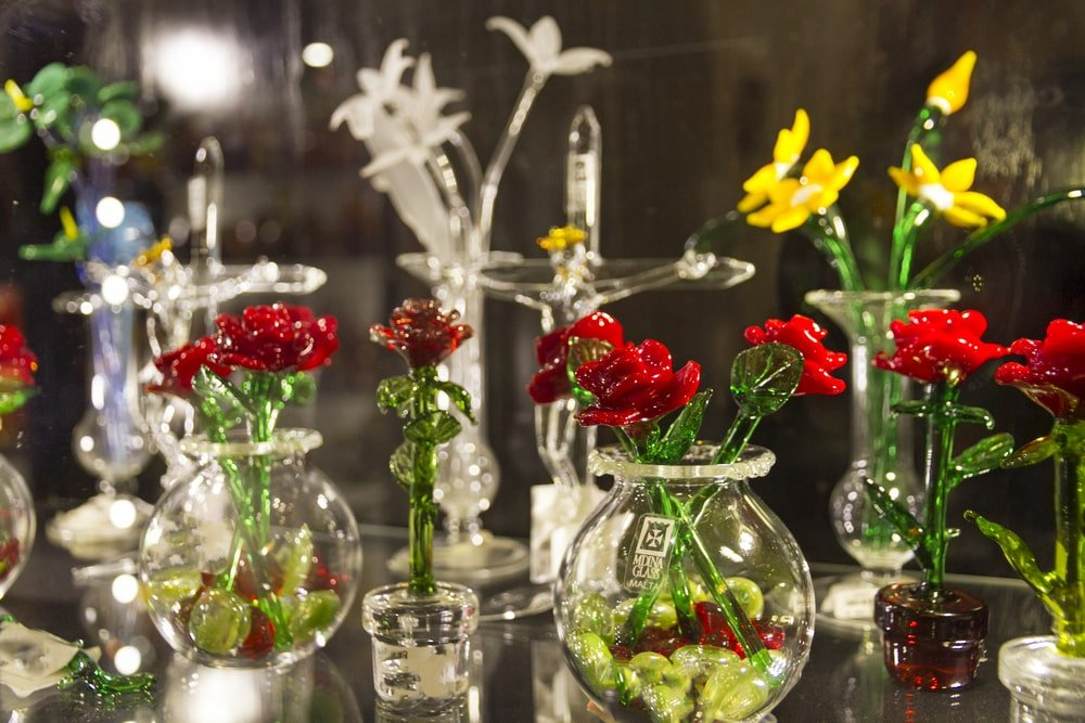 Blown glass flowers for sale at the Citadel in Mdina, Malta.