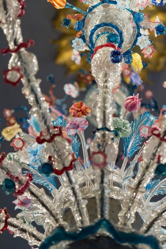 A close-up of glass flowers on an 18th century Murano glass Venetian chandelier.