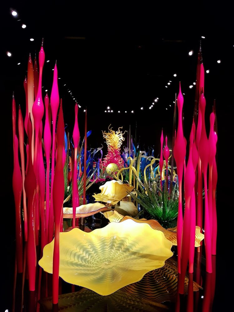 A night view of hand-blown glass floral sculpture.