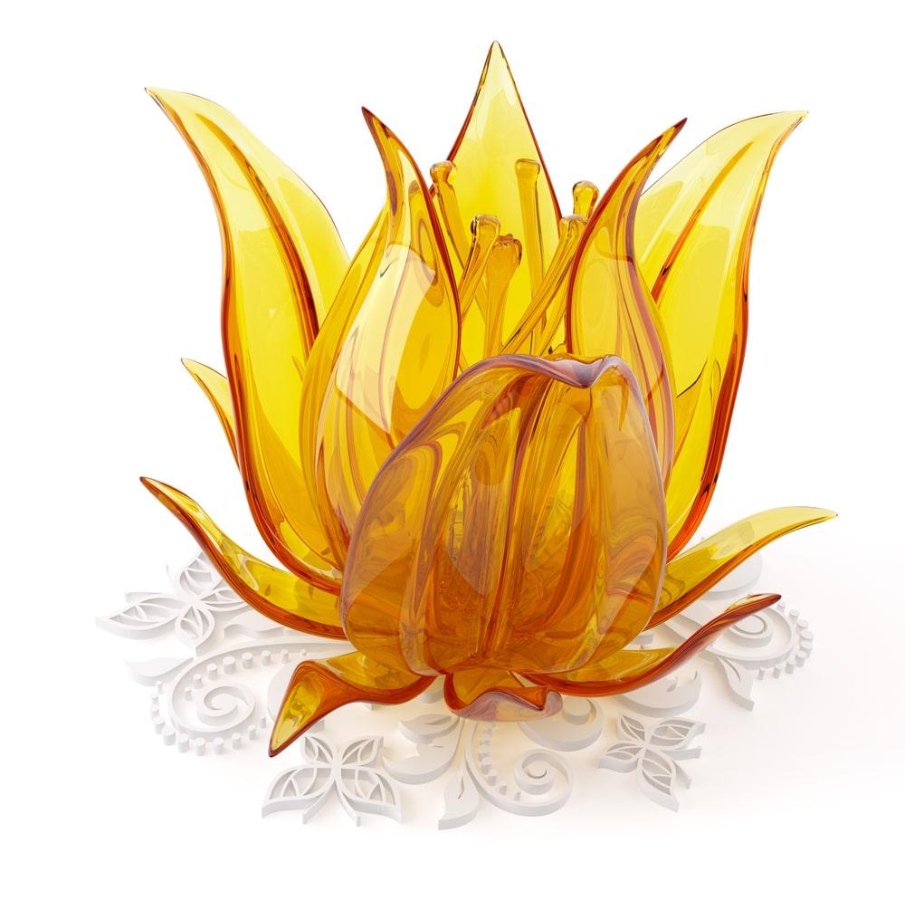 A close look at a golden glass-blown flower.