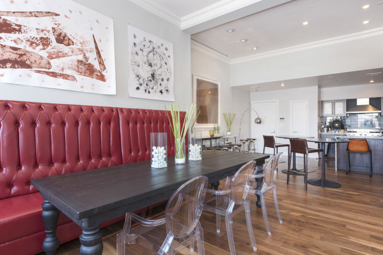 This is a close look at the dining area with a built-in cushioned bench that has red leather to contrast the dark wooden dining table. Image courtesy of Toptenrealestatedeals.com.