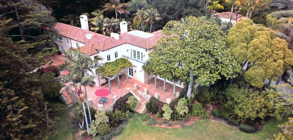 This is an aerial view of the back of the house showcasing the terracotta tone of the floor that matches the roof. You can also see here the various outdoor areas of the house. Image courtesy of Toptenrealestatedeals.com.