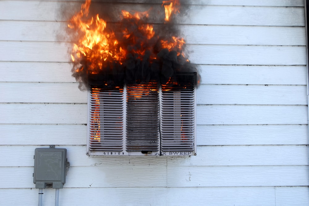 Window-type air conditioner on fire.
