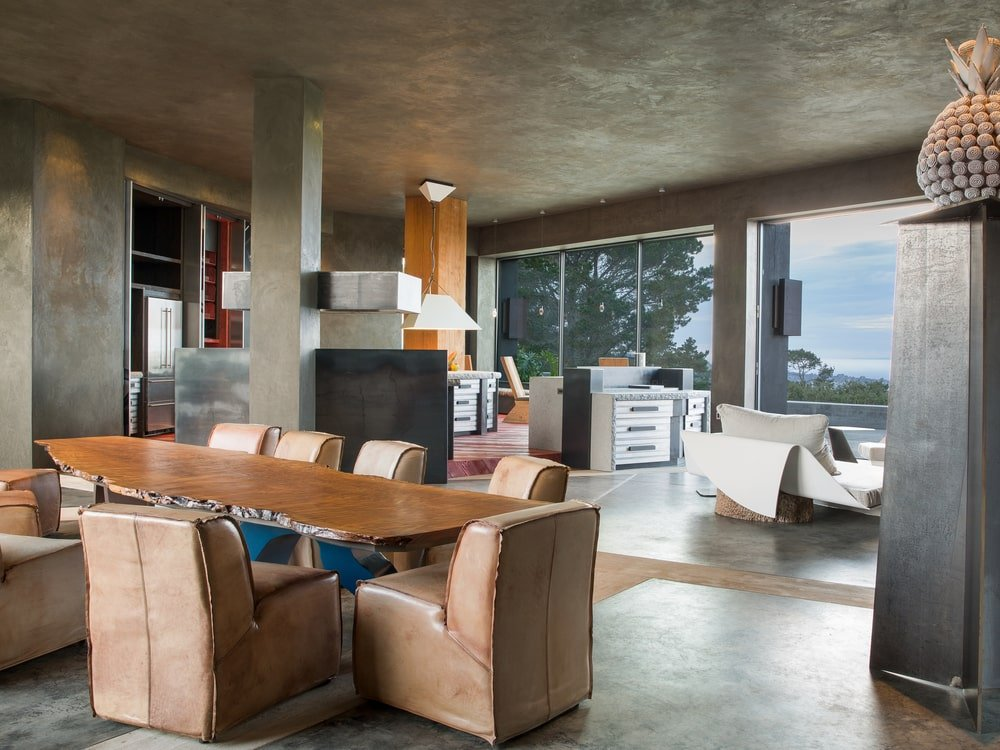 This view of the dining area shows the open design of the great room. You can glimpse the kitchen and the family room area from this vantage. Image courtesy of Toptenrealestatedeals.com.
