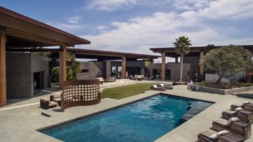 This is the view of the estate featuring the pool surrounded by a large outdoor area that has various sitting and relaxations areas just outside the exterior walls of the house. Image courtesy of Toptenrealestatedeals.com.