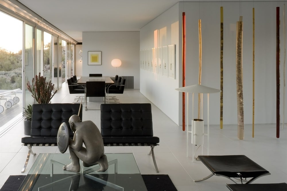 This is a look at the dining area from the vantage of the living room area. It has black modern furniture to match the aesthetic of the living room. Image courtesy of Toptenrealestatedeals.com.