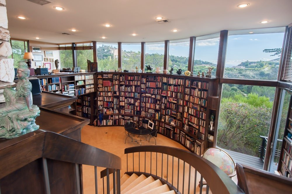 This is a look at the large library from the vantage of the curved staircase leading to the home office. Image courtesy of Toptenrealestatedeals.com.