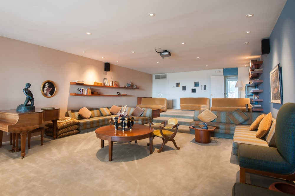 This other view of the living room shows a set of three sofas at the far end on a section that is slightly elevated than the res of the living room. Image courtesy of Toptenrealestatedeals.com.