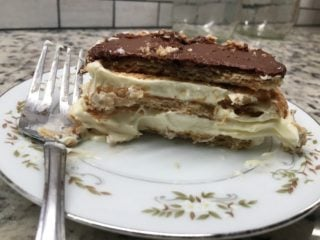 A slice of chocolate eclair cake showing the layers.