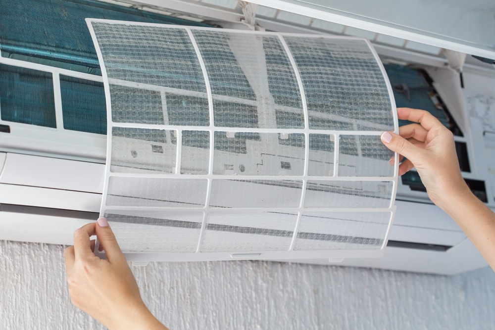 Placing a clean filter for the air conditioner.