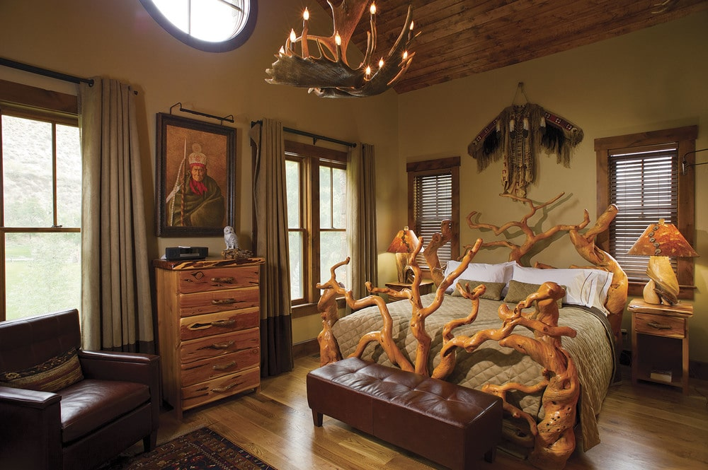 This is the bedroom that has a unique and rustic look to its wooden bed. This matches with the wooden arched ceiling, dresser and the chandelier. Image courtesy of Toptenrealestatedeals.com.