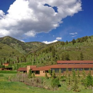 This is an aerial view of the large building of the ranch with a residence along with an equestrian center. This is complemented by the surrounding green landscape. Image courtesy of Toptenrealestatedeals.com.