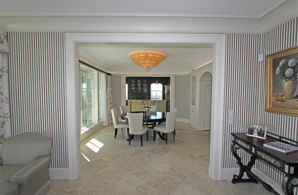 This is the hallway leading to the dining room. This has a console table on the side topped with a painting. Image courtesy of Toptenrealestatedeals.com.