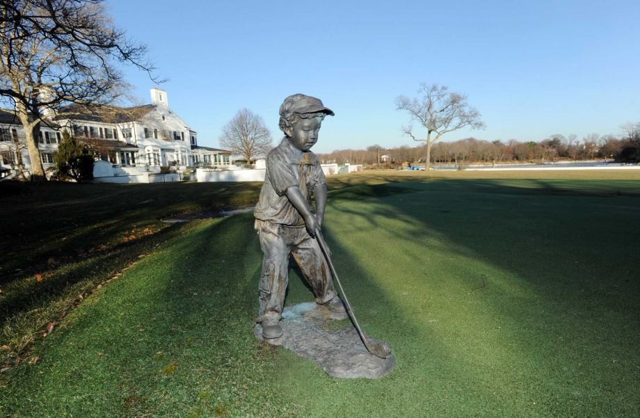 This is a close look at the putting green a few yards from the house. Here you can see that there is a statue of a child playing golf. Image courtesy of Toptenrealestatedeals.com.