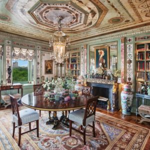 This is a look at the formal dining room of the apartment that is surrounded by detailed and intricate walls that has built-in bookshelves. Image courtesy of Toptenrealestatedeals.com.