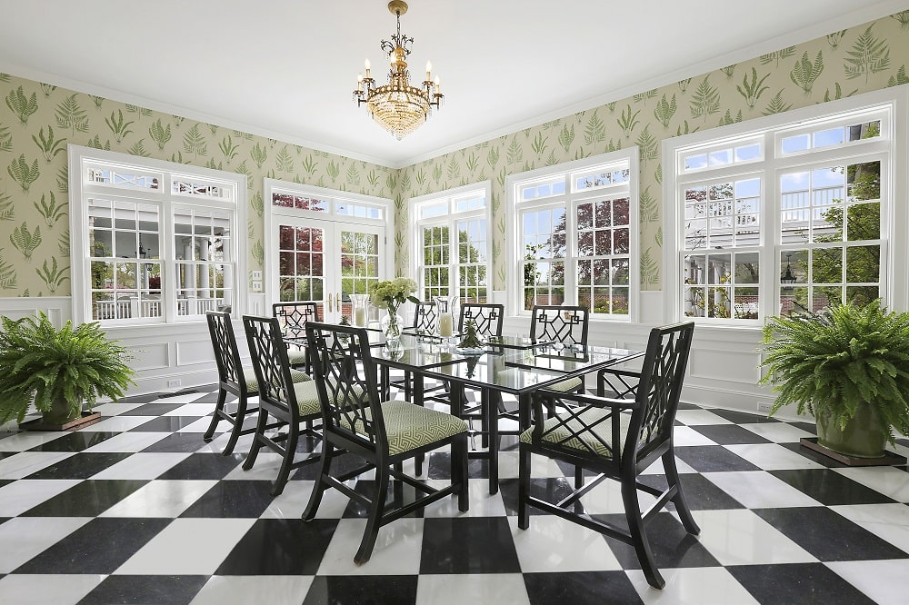 This is the dining room with a checkered black and white flooring under the dining set that has a glass-top dining table. Image courtesy of Toptenrealestatedeals.com.