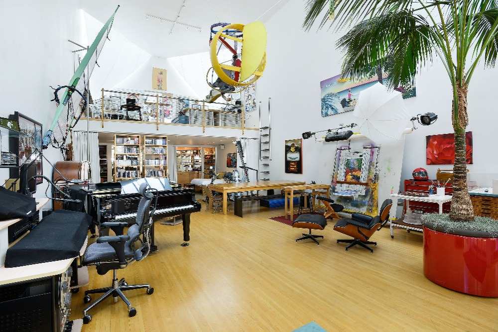 Another view of the room showcasing the working desk, the piano and the table set. Image courtesy of Toptenrealestatedeals.com.