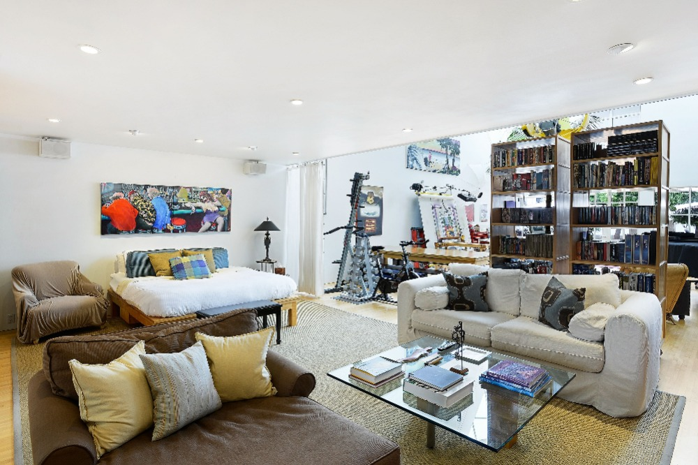 A bedroom featuring a cozy bed set and a personal living space. Image courtesy of Toptenrealestatedeals.com.