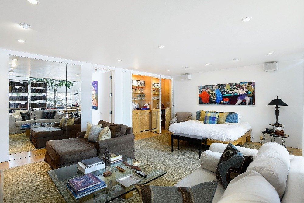 Another look at the bedroom's bed set and personal living space. Image courtesy of Toptenrealestatedeals.com.