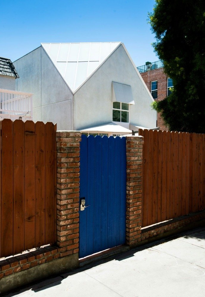 Closer look at the side entry's gate painted in blue. Image courtesy of Toptenrealestatedeals.com.