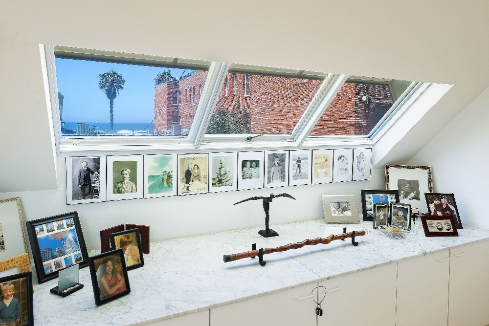 The bathroom also has this marble counter with framed photographs. Image courtesy of Toptenrealestatedeals.com.