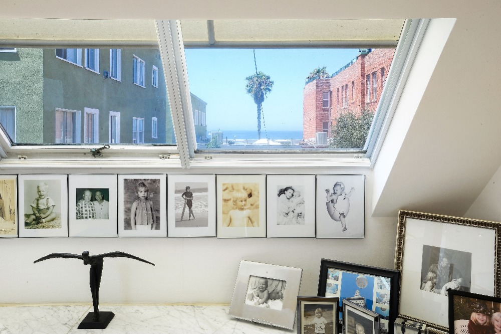 Closer look at the photographs set on this counter by the glass window. Image courtesy of Toptenrealestatedeals.com.