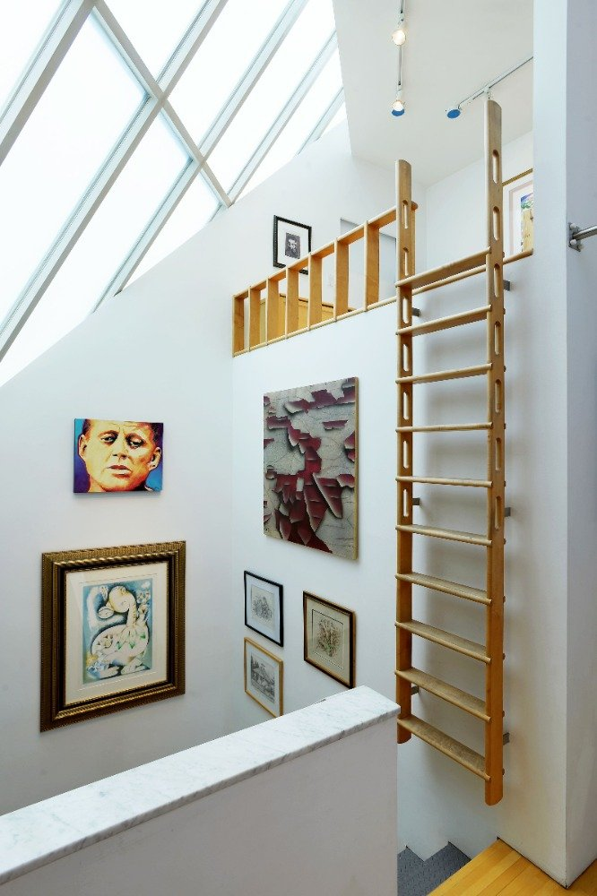 Closer look at the ladder on the wall leading to the loft on top. Image courtesy of Toptenrealestatedeals.com.