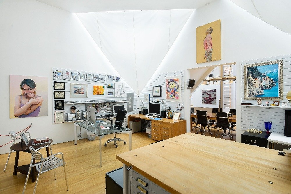 Home office with multiple table sets and a tall ceiling. Image courtesy of Toptenrealestatedeals.com.