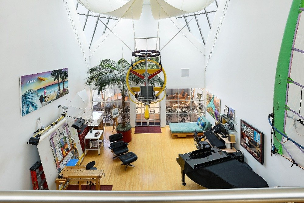 Another view of this room from the second floor, featuring its high custom ceiling. Image courtesy of Toptenrealestatedeals.com.