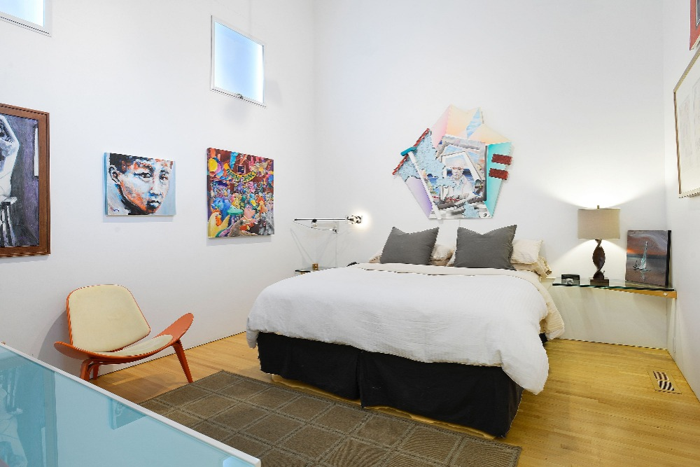 Another view at this bedroom showcasing its modish bed set. Image courtesy of Toptenrealestatedeals.com.