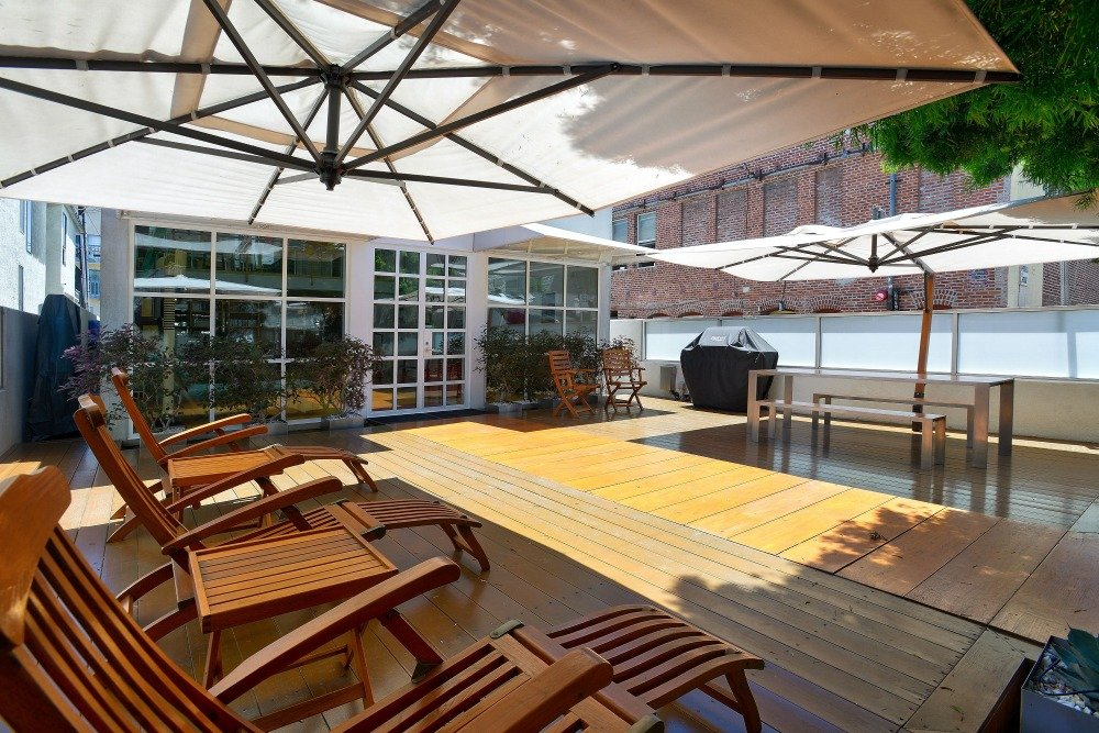 A look of the deck from the sitting lounges facing the outdoor dining set. Image courtesy of Toptenrealestatedeals.com.