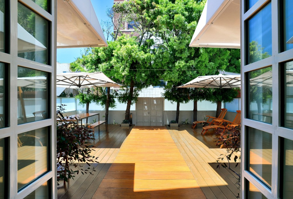 The deck also has a gated entry protected by a whtie fence. Image courtesy of Toptenrealestatedeals.com.