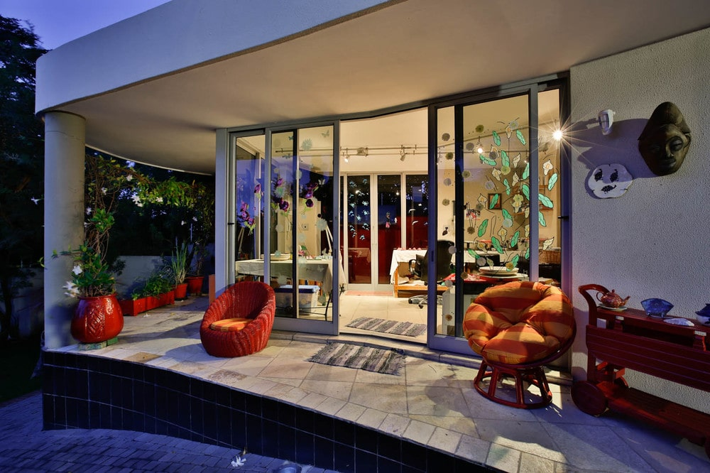 Just outside the sliding glass doors is this patio with a couple of comfortable chairs facing the landscape. Image courtesy of Toptenrealestatedeals.com.
