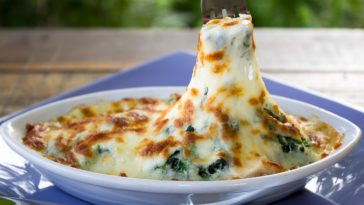 A bowl of four cheese hot spinach dip.