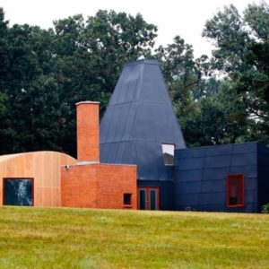 This is a look at the small house that has a quirky design of different shapes and sizes to its different sections. Image courtesy of Toptenrealestatedeals.com.